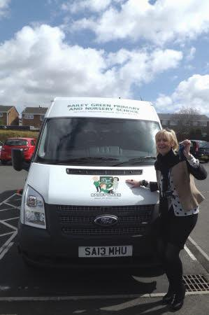 Mrs Taylor is so proud of our mew minibus!