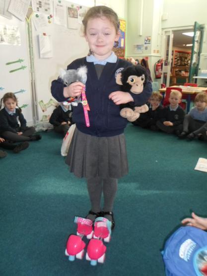 A monkey, Koala, watch and roller skates.