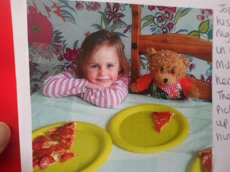 Jofli enjoying his pizza.