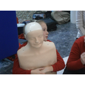 Administering first aid to a choking casualty