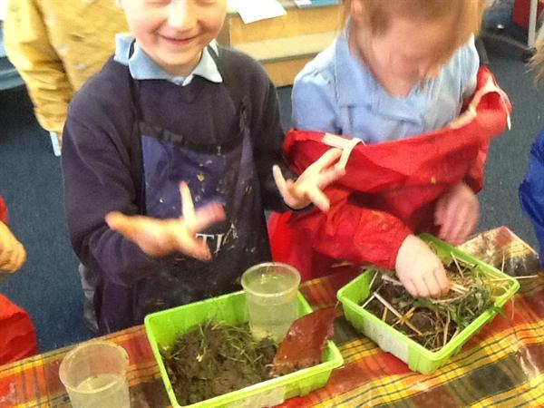 Getting messy searching for mini beasts.