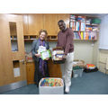 Rev. Wood collects the books and cards.