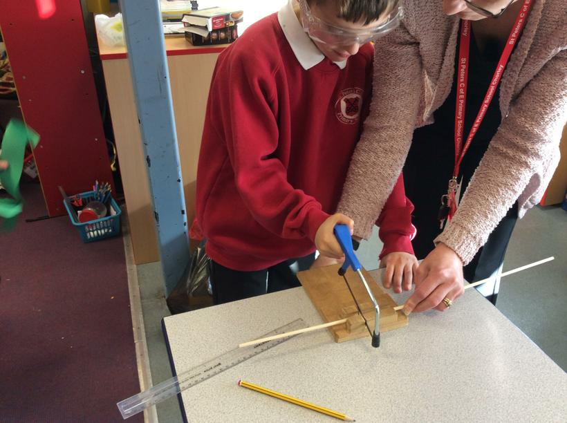 We've used a saw to cut the dowel!