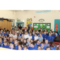 Children waiting patiently for Well Done Assembly
