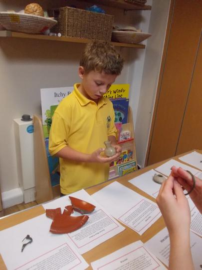 Harry studying an interesting roman artefact.