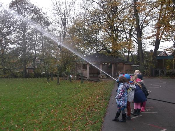Having a go at using the hoses!