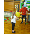 Hollie practising throwing and catching skills.