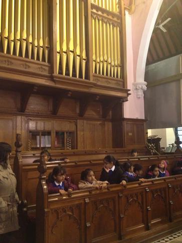 Sat in the choir pews.
