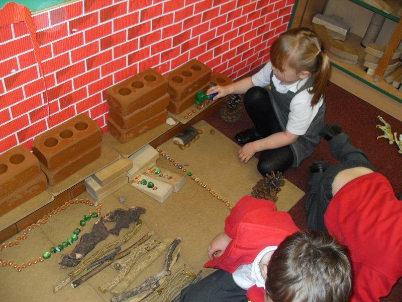 Team work to build a fantasy house and garden!