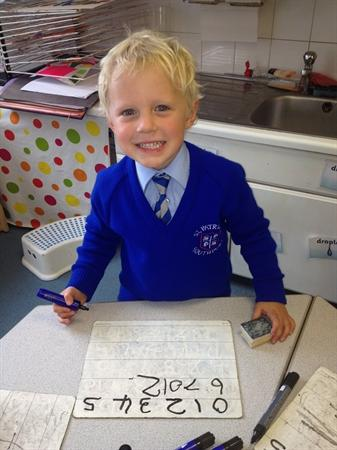 We like to practise counting and writing numbers