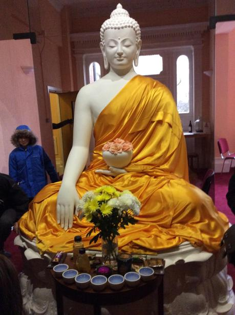 Offerings are made to Buddha