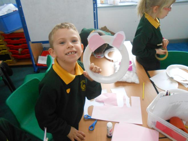 Using paper plates to make bunny masks