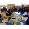 Year 6 investigating the behaviour of ice bergs.