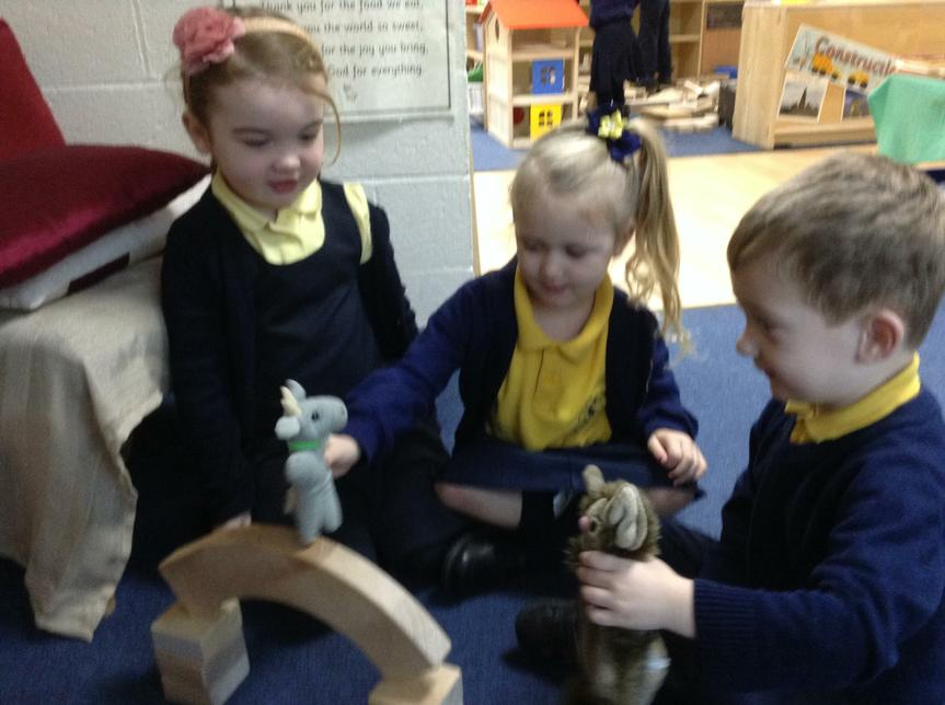 The children acted out the story using puppets.
