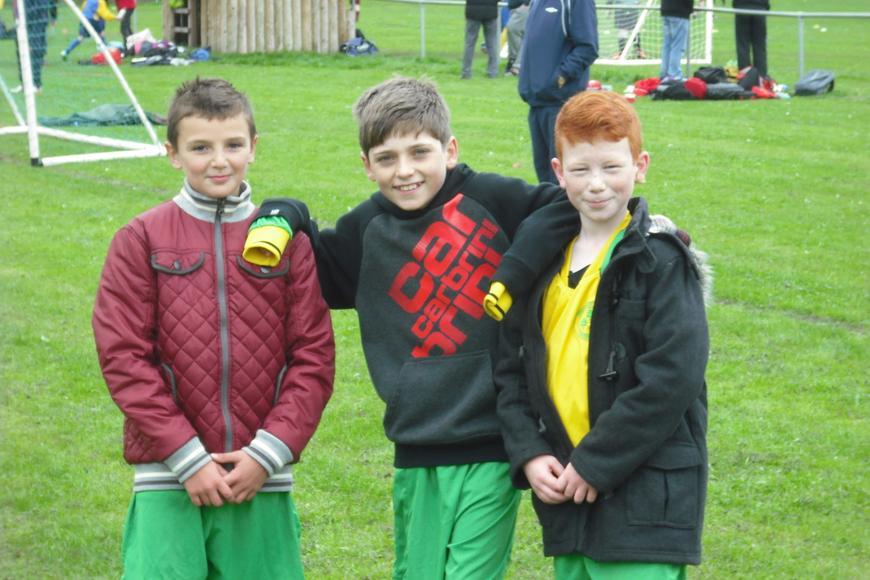 Kian, Adam and Cameron watching the games