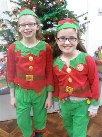 Abby and Hannah come back to school to be elves!!