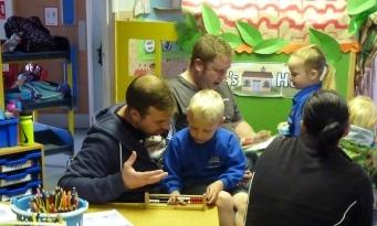 Dads exploring number with their children.