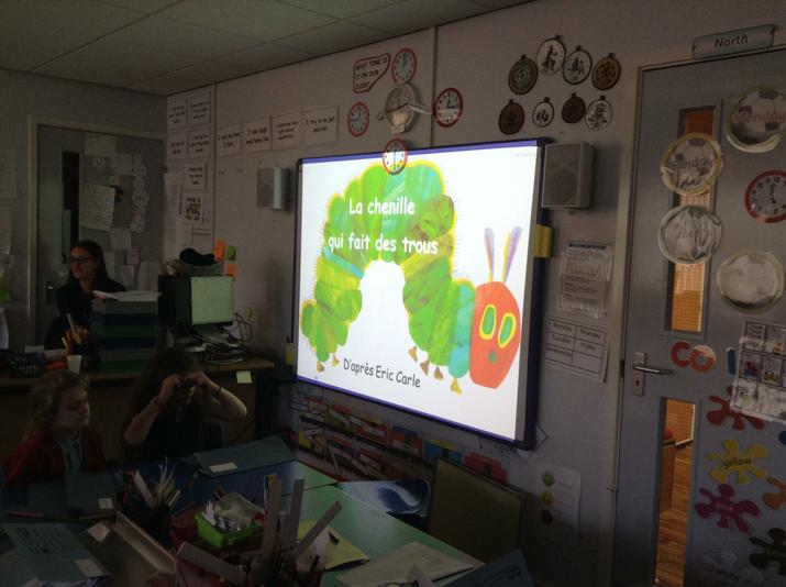 We use the interactive board to read the story