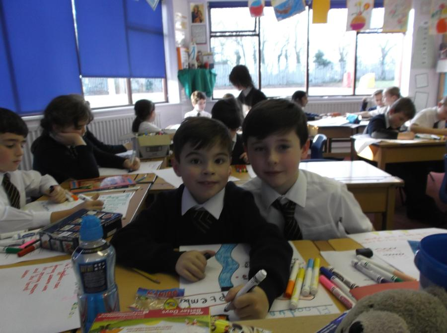 Luca and James creating their super posters!