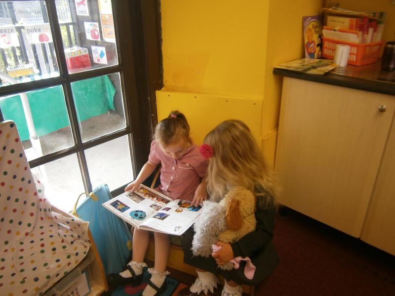 Literacy - sharing books in the reading corner