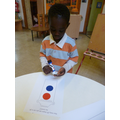 Emmanuel making a 2D shape lantern