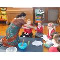 Mrs V helped the children make coconut burfi.