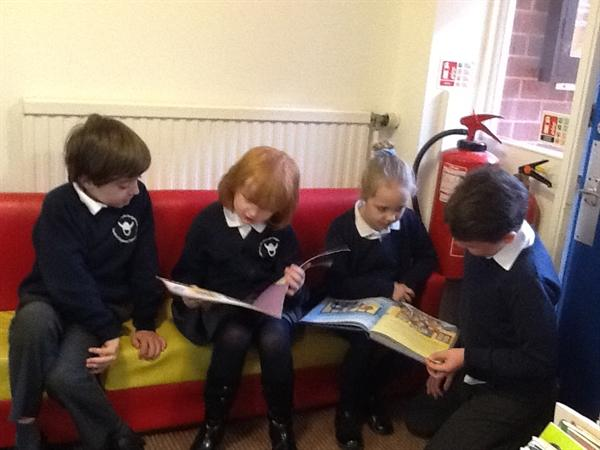 Some of our youngest children sharing books