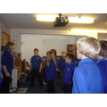Young leaders encouraging singing