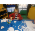Making snowflakes to decorate the classroom