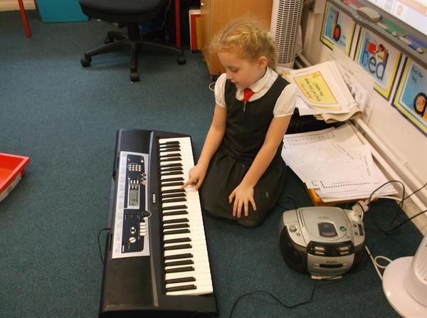 Playing keyboard to our dinosaur song