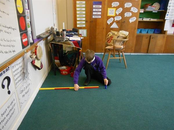 Owls class investigating the size of the school