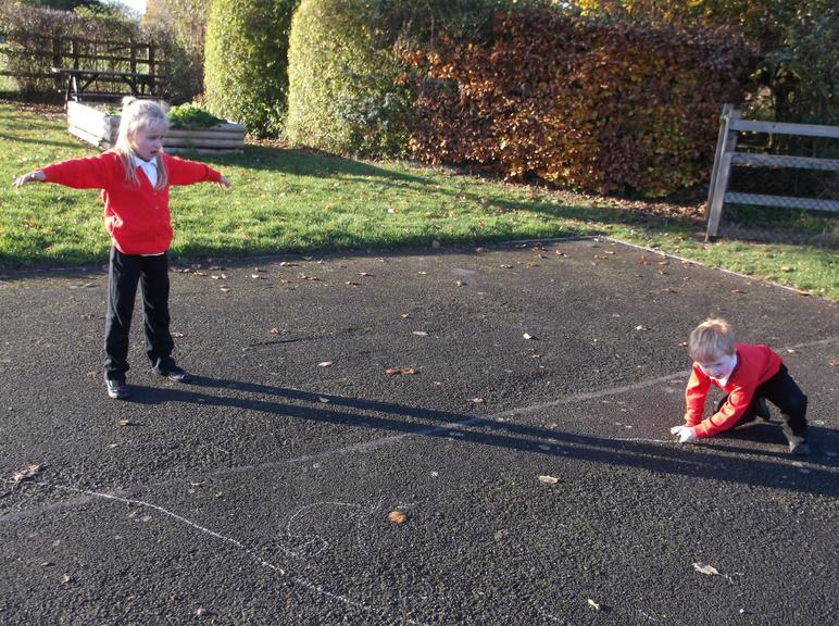 Drawing round our shadows.