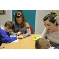 Courtney supporting children with Miss Jowitt