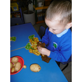 Using play-dough as soil to burying potatoes in!