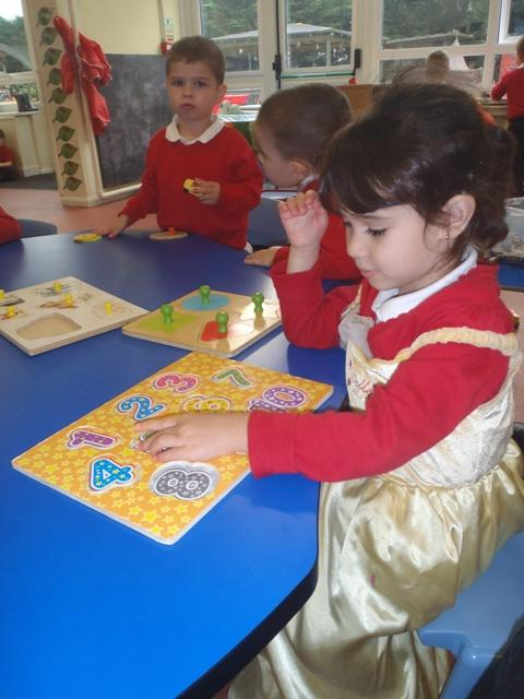Yasmine is beginning to recognise some numbers
