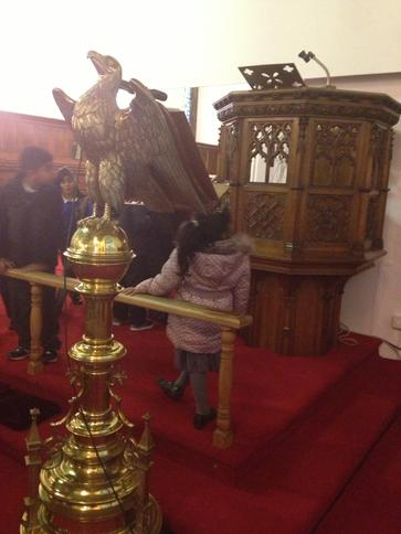 Checking out the pulpit and the lecturn.
