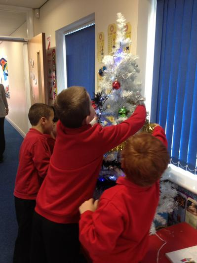 Decorating our recycled tree.