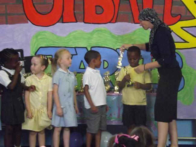Miss Preston gave each of us a Golden Trophy