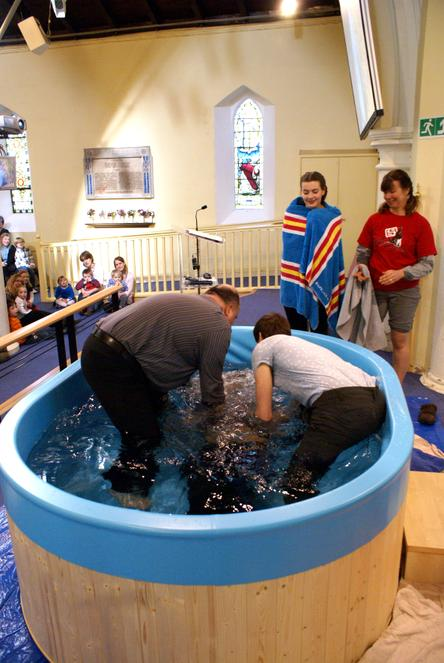 A young man being Baptised by Full Emersion
