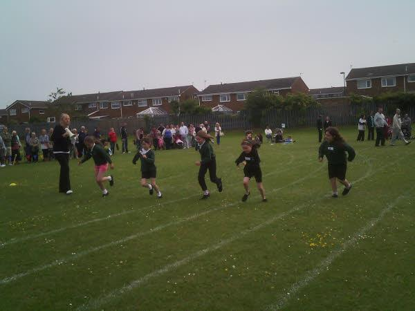 Mrs Taylor encourages the girls in their race