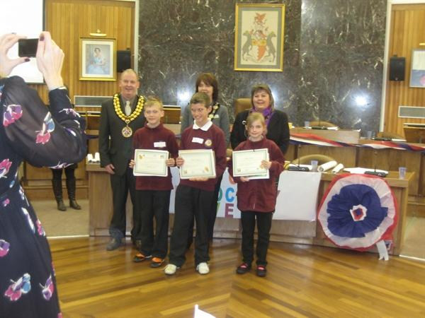 Receiving our certificates from the Mayor