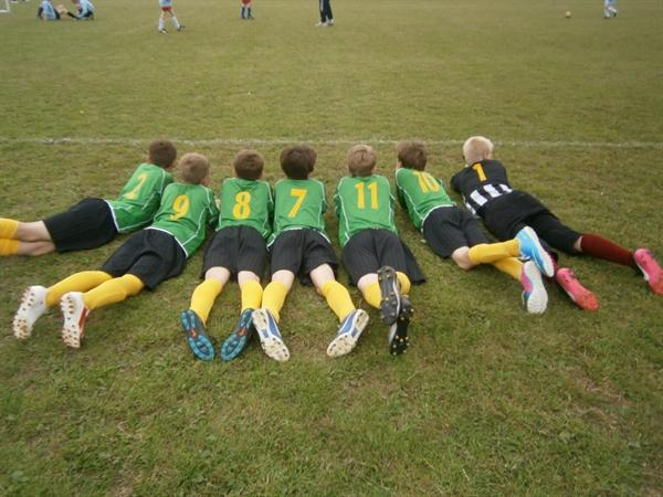 Football team enjoying a break together