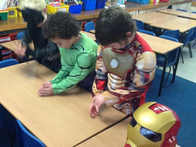 Iron man, Hulk and Batman working in a factory