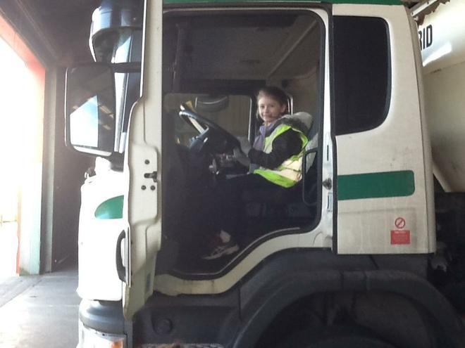 'Driving' the bin lorry!