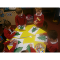 Fine motor practice decorating Christmas trees