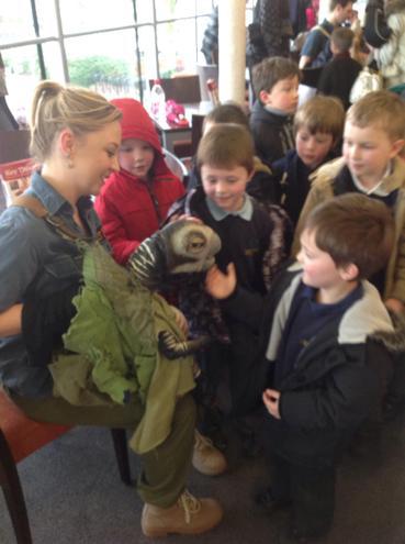 Willow children meet the baby dinosaur puppets.