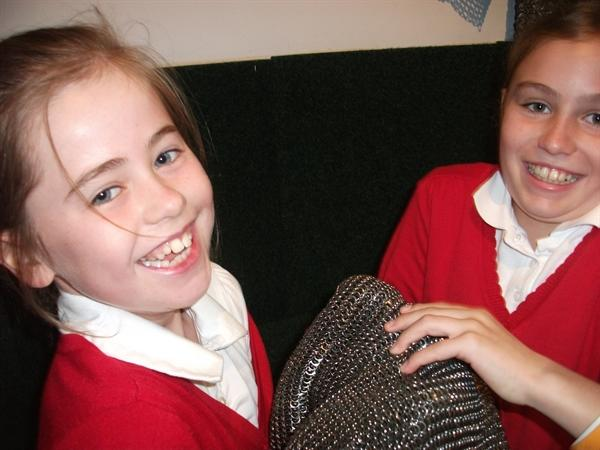 Leila and Lauren holding chainmail