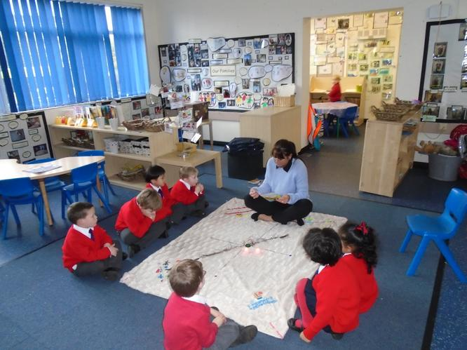 We use our story blanket to create our stories.