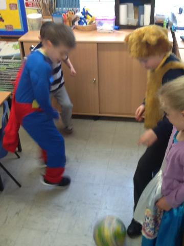 Superman, a Lion and Alice were playing football.