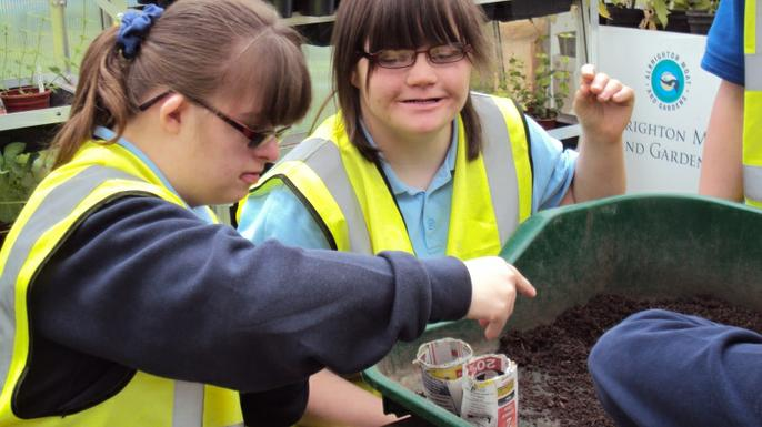 Students exploring recyled materials to make their own pots